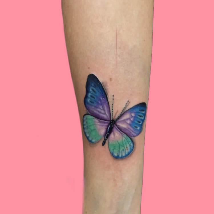Show Beautiful Butterfly Tattoo Designs for Women 69
